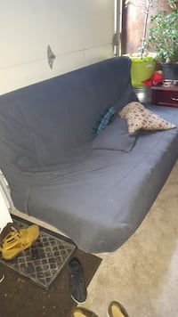 black leather padded futon with brown wooden base Toronto, M1R 2J7