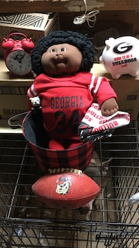 Universality  of Georgia Collectable  # 34 Hersal Walker cabbage patch kid , Georgia fan piggy bank,Georgia wing up alarm clock. Georgia football , One eyed junkyard dog Red & Black plaid basket