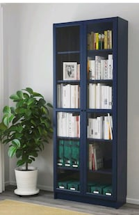 Billy bookcase w glass doors. Never been used