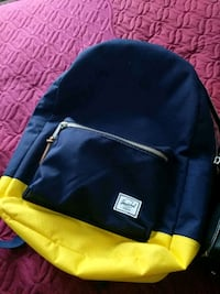 blue and yellow leather backpack Bedford, B4A 1N1