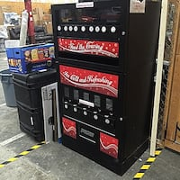 Black and red vending machines for sale. Guelph, N1H 7G5