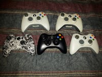 three white Xbox 360 controllers Montreal
