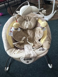 baby's white and gray Fisher-Price bouncer