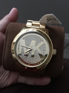 gold Michael Kors analog watch with link strap