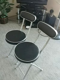 black and gray metal bar stools