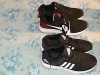pair of black-and-white adidas sneakers 792 km