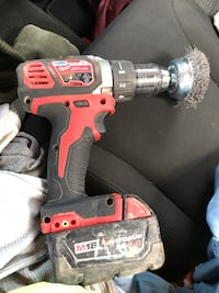 red and black cordless hand drill