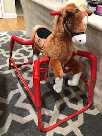 Red and brown radio flyer spring rocking horse