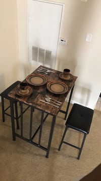black and brown wooden table with chairs Alexandria, 22305