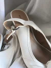 pair of white leather slip on shoes O'Fallon, 63366