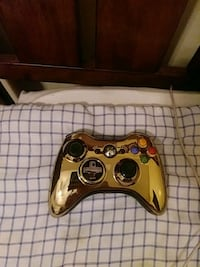 Gold and black Xbox 360 controller