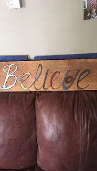 Believe wooden signage