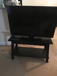 Flat screen tv and black wooden tv stand Falls Church, 22043