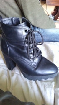 pair of black leather heeled booties Mission