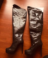 Knee-high black boots size 7.5 Palm Harbor, 34685