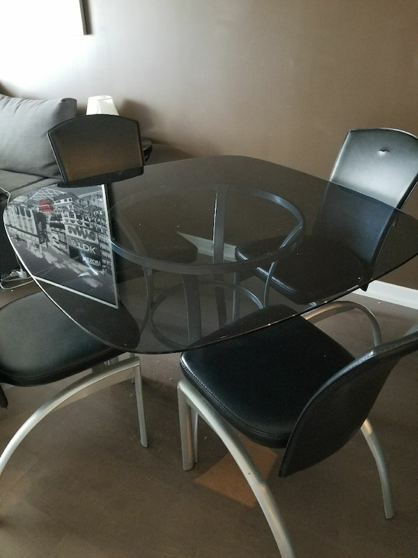 Glass dining table set with 4 chairs