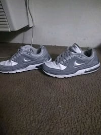 pair of gray-and-black Nike sneakers Las Vegas, 89169