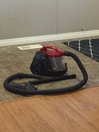 black and red corded angle grinder Leduc