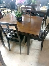 rectangular brown wooden table with four chairs dining set Indianapolis, 46219
