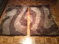 Two brown and taupe chinese rugs. Size 70 x 120 cm