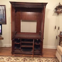 brown wooden TV hutch 566 mi