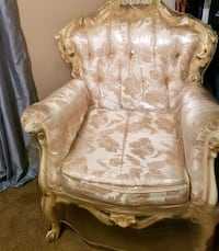 brown wooden framed brown floral padded armchair