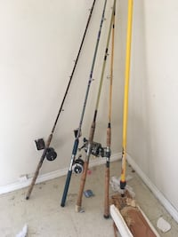 two black and gray fishing rods