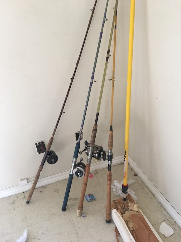 two black and gray fishing rods ec005485-6fc3-4a85-aaa2-41709e06f18a