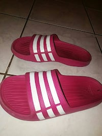 white-and-red Adidas slide sandals