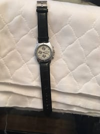 round silver-colored chronograph watch with black leather strap Montréal, H4L 3C2
