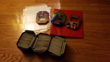Pokemon cards at least 600 cards including (tins card sleeves and more