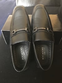 pair of black leather loafers 52 km