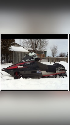 black and red Polaris snow mobile