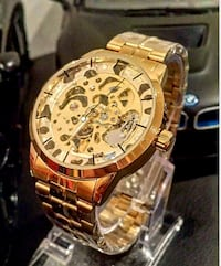 Glass globe gold tone stainless automatic watch