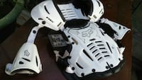 white and black Fox shoulder pad