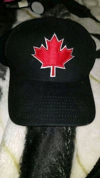 black and red maple leaf embroidered curved-brim cap Calgary, T2W 2T6