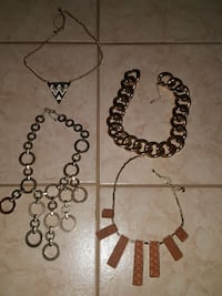 four silver-colored chain necklaces Vaughan