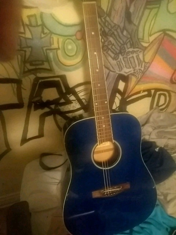 blue and black acoustic guitar