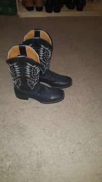 pair of black leather cowboy boots Houston, 77074