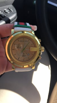 round gold-colored chronograph watch with green strap Clarksburg, 20871
