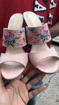 pair of white-and-pink sandals