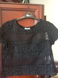 New women's top size medium  Laval, H7X 3R8