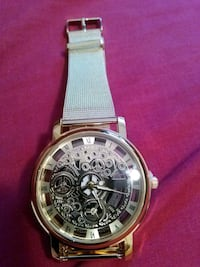 round silver-colored skeleton watch with black leather band Kissimmee, 34743
