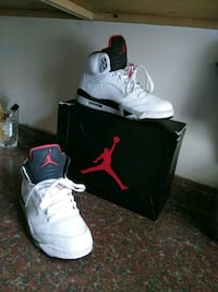 black-and-white Air Jordan basketball shoes with box