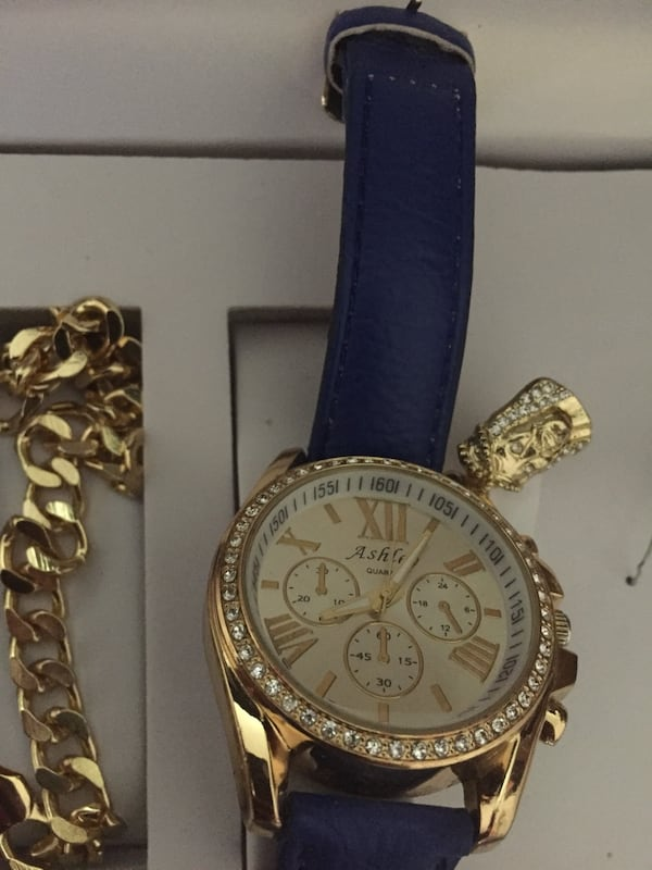 round gold-colored chronograph watch with blue leather strap 582ddba5-15d7-49c8-af07-5f93358e0fff