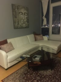 White leather sectional sofa with throw pillows Toronto, M3C 1V1