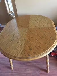 round brown wooden table with two chairs Edmonton, T5T 7E3