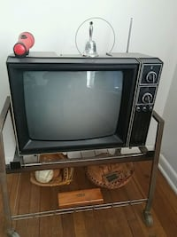 black CRT television with brown wooden TV stand San Antonio, 78210