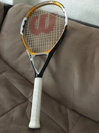 white and red Wilson tennis racket Doral, 33178