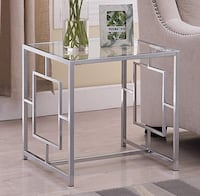 Chrome & glass 4 pc table set. Sofa table, coffee table, 2 end tables